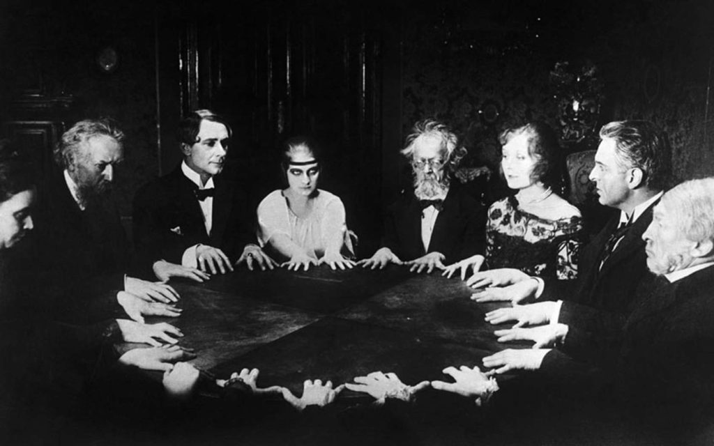 Seance Scene in Dr. Mabuse the Gambler...22 May 1922, Germany --- Seance scene in the German silent film Dr. Mabuse, der Spieler (in English Dr. Mabuse: The Gambler) directed by Fritz Lang and starring Rudolf Klein-Rogge. --- Image by Bettmann/CORBIS