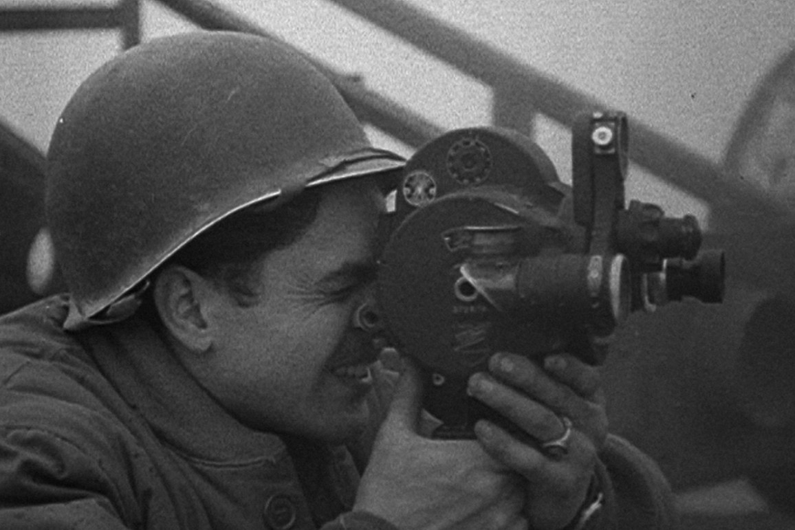A soldier with a camera in Five Came Back (2017)