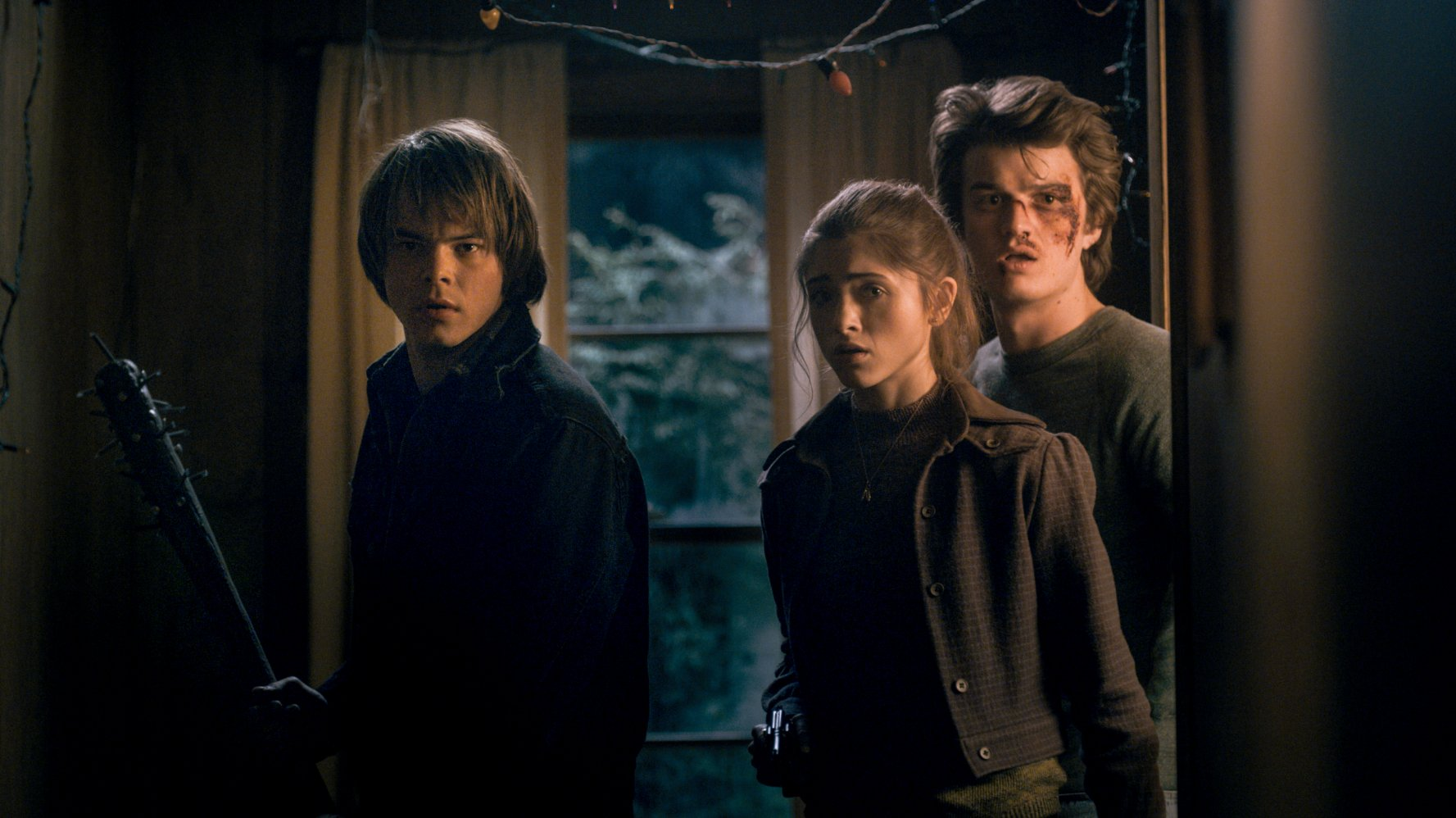 Charlie Heaton as Jonathan Byers, Natalia Dyer as Nancy Wheeler, and Joe Keery as Steve Harrington in STRANGER THINGS (2016)