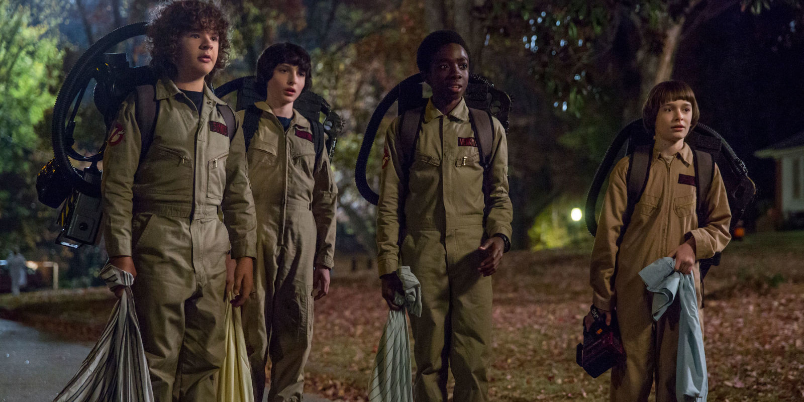 Gaten Matarazzo as Dustin, Finn Wolfhard as Mike, Caleb McLaughlin as Lucas, and Noah Schnapp as Will Byers dressed as Ghostbusters in STRANGER THINGS 2 (2017)