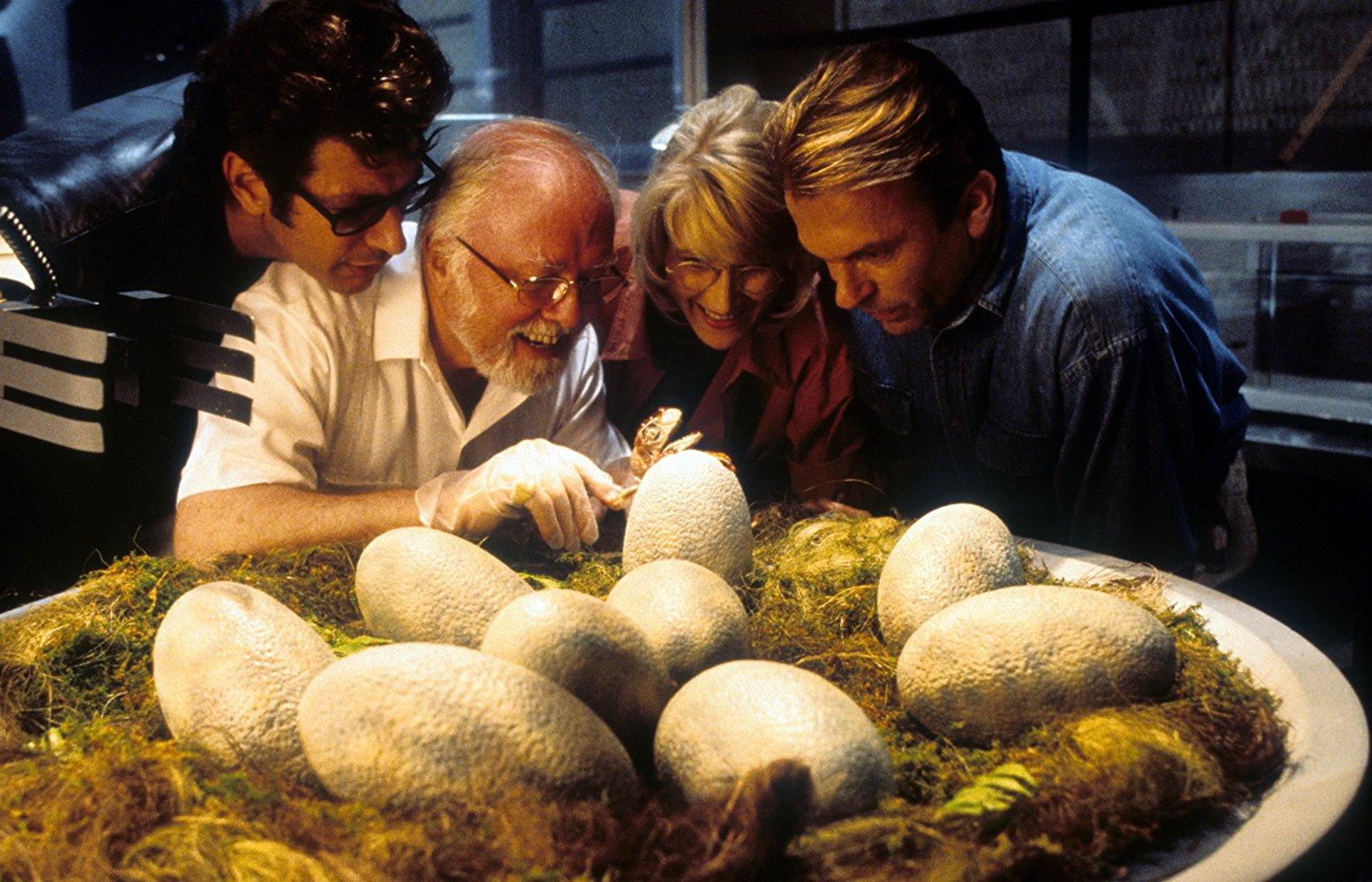 Jeff Goldblum, Richard Attenborough, Laura Dern, and Sam Neill look at dinosaur eggs in JURASSIC PARK (1993)