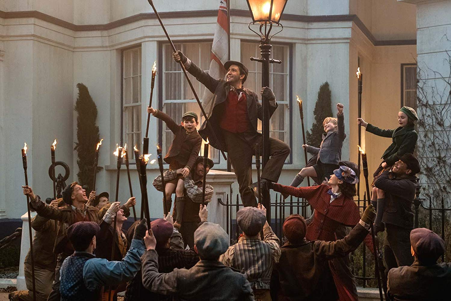 """Lin-Manuel Miranda's Jack leads the lamplighters and the Banks children in """"Trip a Little Light Fantastic"""" in MARY POPPINS RETURNS (2018)"""
