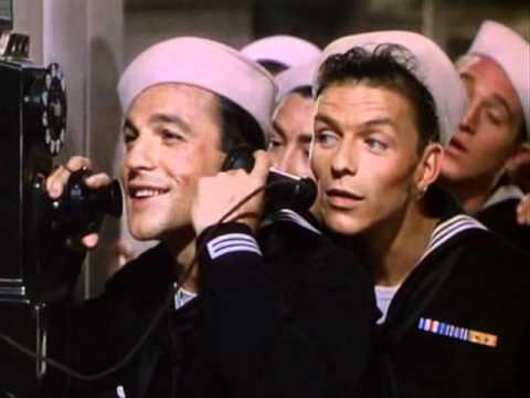 Gene Kelly (flanked by Frank Sinatra)