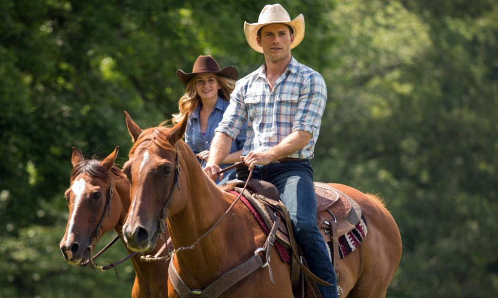 "This photo provided by Twentieth Century Fox shows ,Scott Eastwood as Luke, and Britt Robertson, as Sophia, in a scene from the film, ""The Longest Ride,"" directed by George Tillman, Jr. The movie releases in the U.S. on April 10, 2015. (AP Photo/Twentieth Century Fox, Michael Tackett)"
