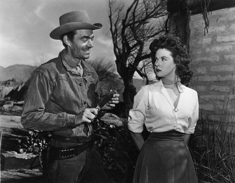 Jack Elam ogles Susan Hayward in RAWHIDE.