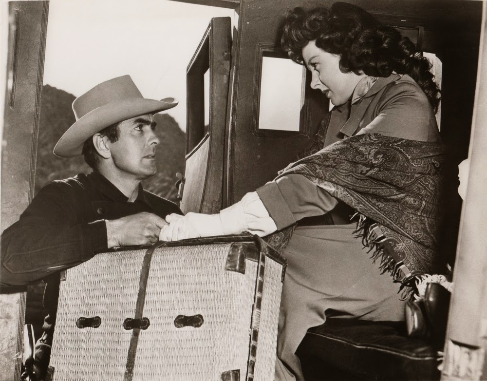 Tyrone Power greets Susan Hayward in RAWHIDE.