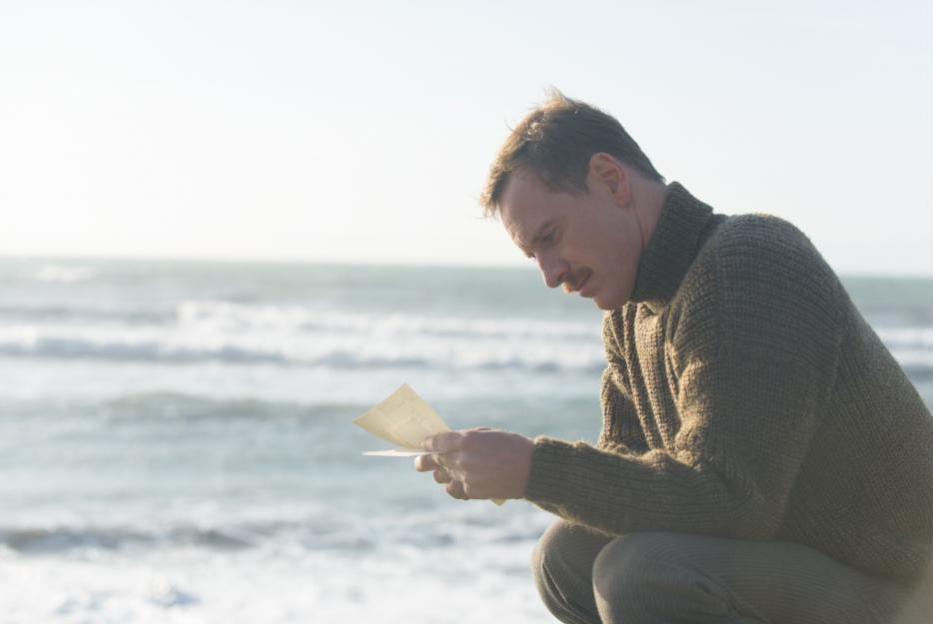 Michael Fassbender reads a letter in The Light Between Oceans (2016)