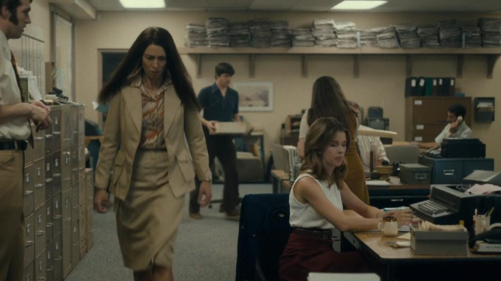 Rebecca Hall as Christine, storming through the newsroom.