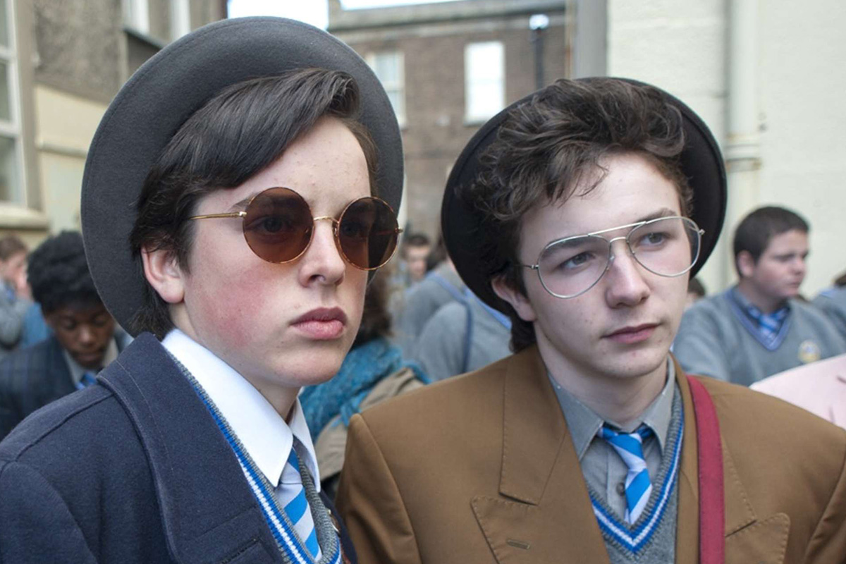 "FERDIA WALSH-PEELO and MARK MCKENNA star in ""SING STREET."" (Photo: The Weinstein Company)"