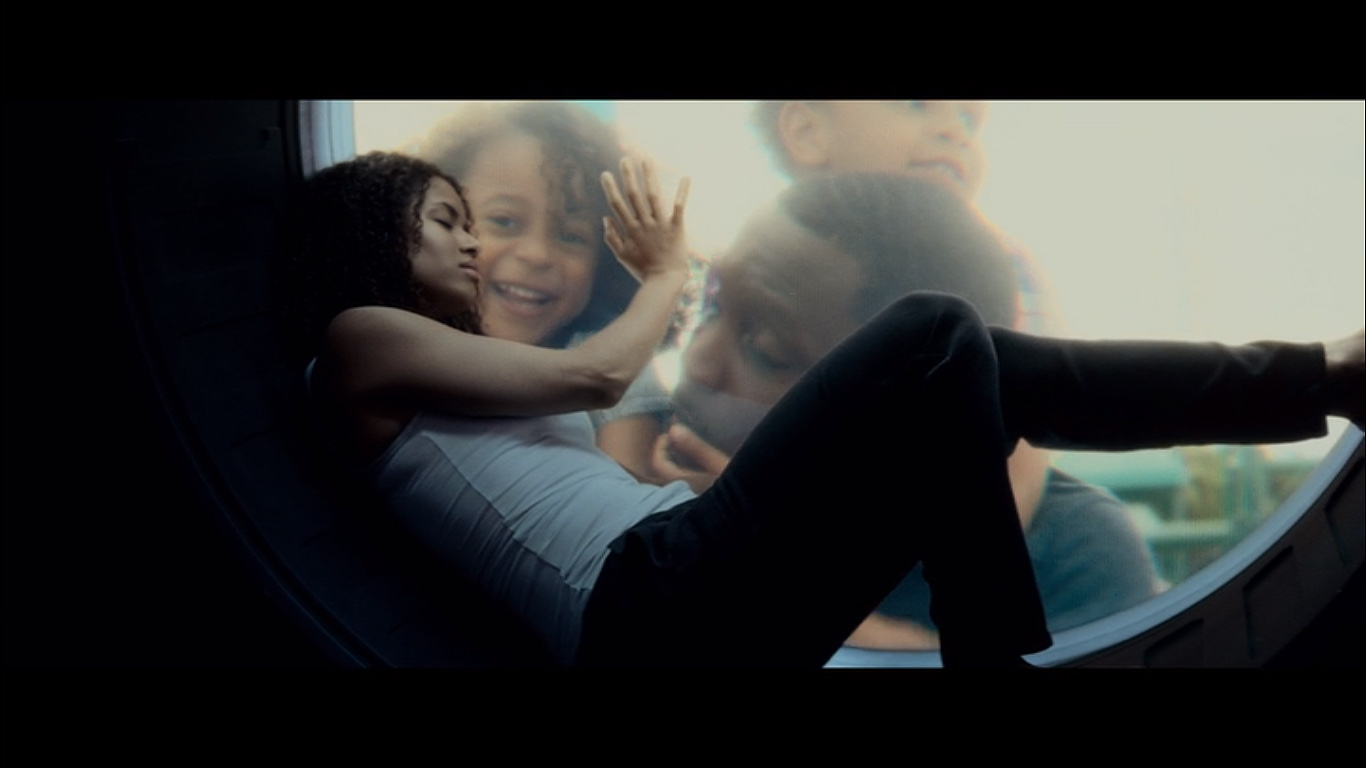 Hamilton (Gugu Mbatha-Raw) touches a screen with the image of her family in THE CLOVERFIELD PARADOX (2018)