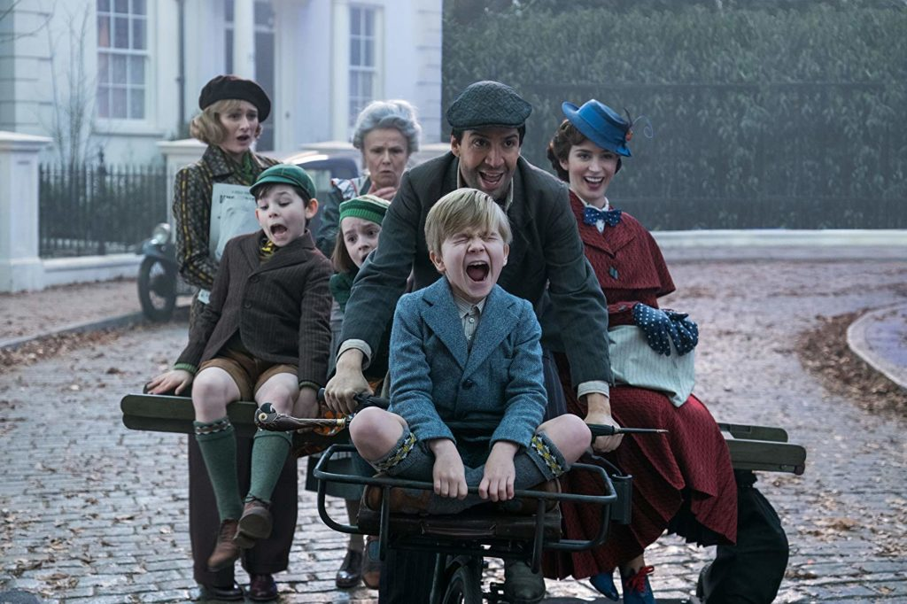 Emily Mortimer, Nathanael Saleh, Pixie Davies, Julie Walters, Lin-Manuel Miranda, Jack Dawson, and Emily Blunt ride a bike in MARY POPPINS RETURNS (2018)