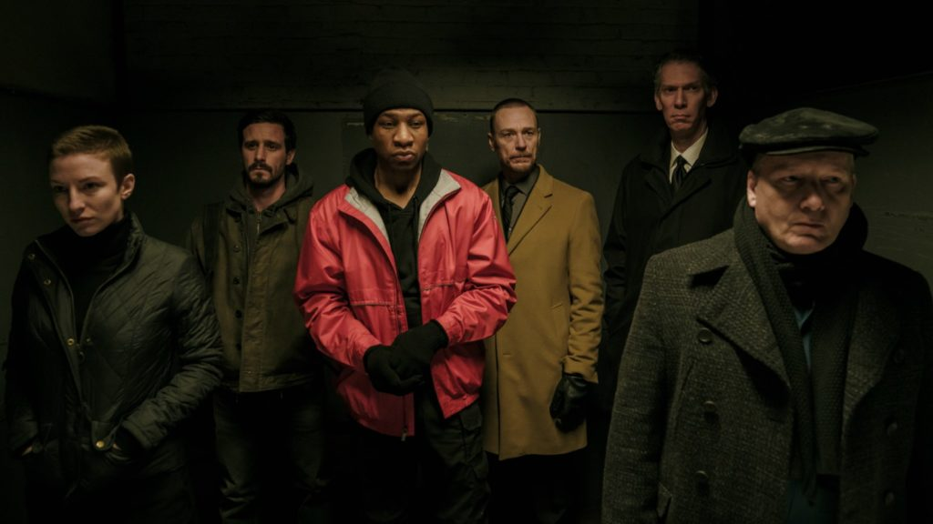 Caitlin Ewald, James Ransone, Jonathan Majors, Ben Daniels, Lawrence Grimm, and Guy Van Swearingen in CAPTIVE STATE (2019)