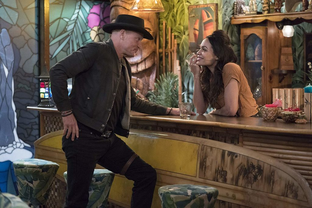 Woody Harrelson and Rosario Dawson flirt at a bar in ZOMBIELAND: DOUBLE TAP (2019)