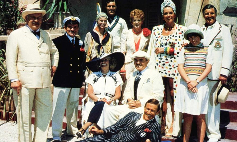The cast of EVIL UNDER THE SUN, Roddy McDowall (reclining), seated from left: Sylvia Miles, James Mason, standing from left: Peter Ustinov, Colin Blakely, Jane Birkin, Nicholas Clay, Maggie Smith, Diana Rigg, Emily Hone, Denis Quilley, 1982.