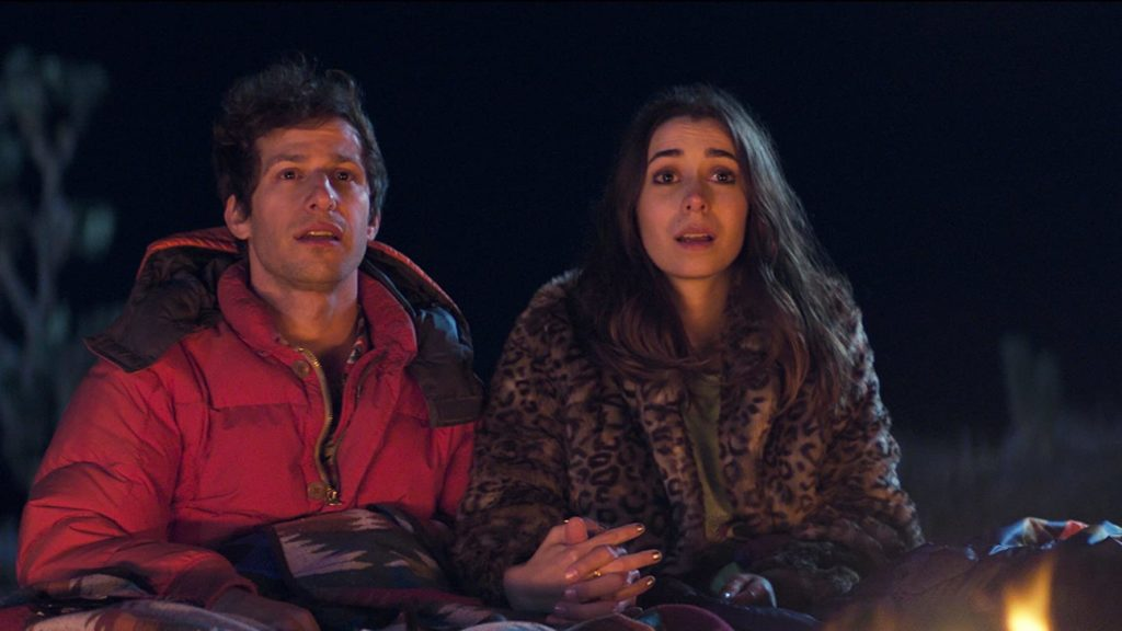 Andy Samberg and Cristin Milioti holding hands in the desert at night in PALM SPRINGS (2020)