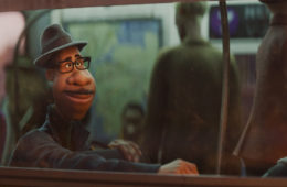 Joe Gardner (voiced by Jamie Foxx) rides a subway in SOUL (2020)