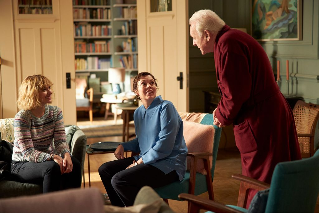 a dementia-restores personhood to the victims of the victims of the disease, including the two grandmothers I thought I'd never be able to connect with again.Anthony knows something is wrong, but he can't quite put his finger on it.   One moment, his daughter Anne (Olivia Colman) tells him she's moving, but later she says that's not true. He's not sure who this man is in his apartment is, and he's not sure why his home looks different than he remembered. He's certain his daughter and her husband are trying to take it away from him, and he doesn't know whom he can trust anymore. What Anthony (Anthony Hopkins) doesn't know: He has dementia, and Anne is as overwhelmed trying to figure out how to take care of him.   If you've never been close with someone suffering from progressive memory loss, The Father may feel like a strange film. Anthony is one of the most unreliable narrators I've ever seen on screen, and his personality changes by the scene. Many of the filmmaking choices are strange as well. Why do some actors play several roles? Why do they change personalities? Are we jumping forward and backward in time? Why does the apartment look like one long continuity error with changing décor and a confusing floor plan?   However, if you are one of the many millions (perhaps billions) of people who have watched someone you love suffer from dementia, you'll realize almost immediately what is happening. Depending on the stage of the disease, you may have already witnessed scenes just like these hundreds (perhaps thousands) of times over. I know this because I have lost both of my grandmothers to this fate before they lost their lives. When we buried my father's mother, I felt like I'd been saying goodbye for three years. Though I missed her as much as ever, it was almost a relief to see my grandfather finally given a respite.  In the last year, I've watched my mother attempt to manage her own mother's care during COVID, which has included moving her out of our home into a