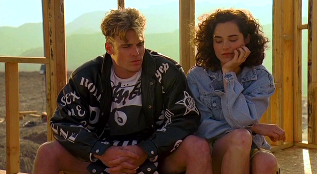 Vanilla Ice and Kristin Minter hang out at a construction set in COOL AS ICE (1991)